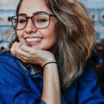 closeup-photo-of-smiling-woman-wearing-blue-denim-jacket-1130626
